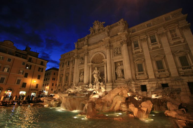 Why do we toss coins in the Trevi Fountain?