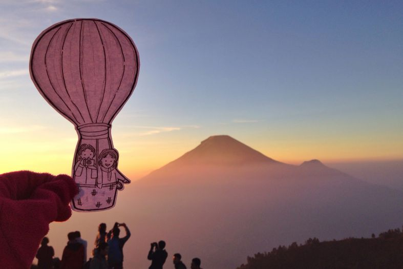 This traveling cartoon couple will inspire you to see the world